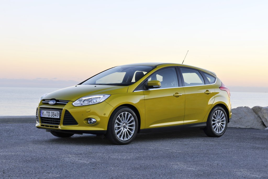 2012 Ford Focus hatchback exterior yellow front left side static